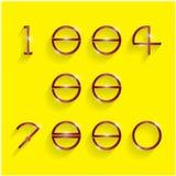 Shinning cirkelsiffrastil på gul bakgrund Arkivbilder