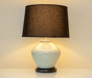 Shinning lamp on bedside table Stock Photography