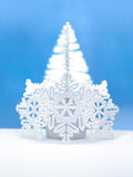Shinny Christmas Tree and White Snowflakes. Over Blue Background Royalty Free Stock Images