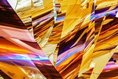 Shinny Hängen segeln abstrakten Hintergrund in den Gelbs und Orangen mit blau-purpurroten Höhepunkten stock abbildung