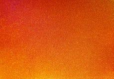 Shinny il fondo arancio di scintillio Fotografia Stock