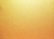 Shinny il fondo dorato di scintillio Immagini Stock