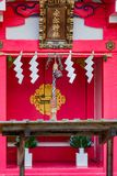 Shinto Altar. A red and locked outdoor shinto altar in Japan Royalty Free Stock Photo