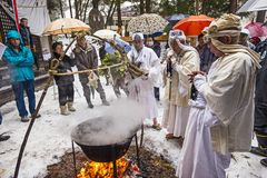 Shinto Ceremony. NAGANO, JAPAN - FEB 4, 2013: Shinto Ascetics perform ancient purifying rites. Known as Yamabushi, they are mountain hermits with a long stock photos