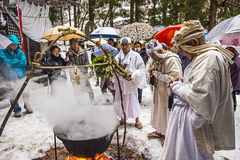 Shinto Ceremony. NAGANO, JAPAN - FEB 4, 2013: Shinto Ascetics perform ancient purifying rites. Known as Yamabushi, they are mountain hermits with a long royalty free stock photography