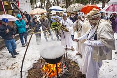 Shinto Ceremony. NAGANO, JAPAN - FEB 4, 2013: Shinto Ascetics perform ancient purifying rites. Known as Yamabushi, they are mountain hermits with a long royalty free stock images