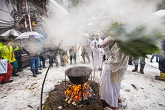 Shinto Ceremony. NAGANO, JAPAN - FEB 4, 2013: Shinto Ascetics perform ancient purifying rites. Known as Yamabushi, they are mountain hermits with a long Royalty Free Stock Photos