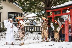 Shinto Ceremony. NAGANO, JAPAN - FEB 4, 2013: Shinto Ascetics perform ancient rites during a procession. Known as Yamabushi, they are mountain hermits with a royalty free stock photos