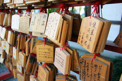 Shinto ema plaques. TOKYO - CIRCA NOVEMBER 2013. Ema prayer tables at Toshogu Shrine. Ema are small wooden plaques used for wishes by shinto believers royalty free stock photography
