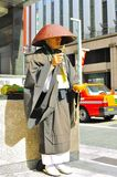 Shinto monk ringing bell for donation. A monk chanting and ringing bell asking for donation in Tokyo Stock Images