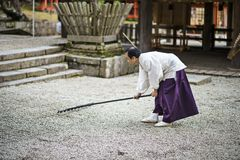 Shinto Priest Attending Zen Garden Royalty Free Stock Image