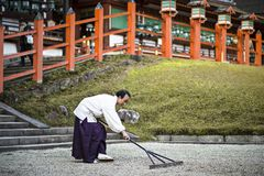 Shinto Priest Attending Zen Garden Royalty Free Stock Photo