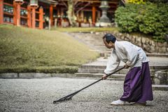 Shinto Priest Attending Zen Garden Royalty Free Stock Images