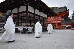Shinto priests prepare for the praying ceremony in Shimogamo Shrine in Kyoto. KYOTO, JAPAN - DEC 09: Shinto priests prepare for the praying ceremony in Shimogamo stock photo
