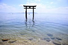 Beautiful shinto shrine in the clear ocean of Japan. Shinto shrines are found everywhere in japan. here is one coming out of the clear water of the ocean Stock Photos