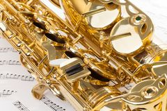 Shiny alto saxophone with detailed view of keys Stock Image