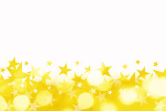 Shiny background of golden bokeh lights with stars Royalty Free Stock Image