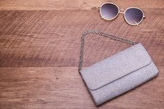 Shiny bag, glasses, place for text. Women`s accessories and free space royalty free stock image