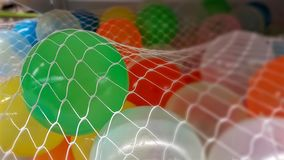 Colorful balloons in white net royalty free stock image