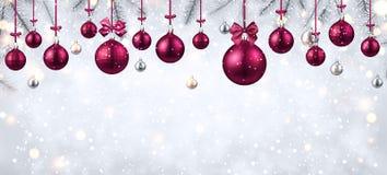 Shiny banner with pink Christmas balls. Shiny New Year banner with fir branches and pink Christmas balls. Vector illustration Royalty Free Stock Photography