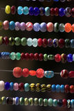 Shiny beads. Glass beads on display for sale Royalty Free Stock Images