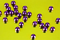 Shiny beads. On a shiny background Royalty Free Stock Images