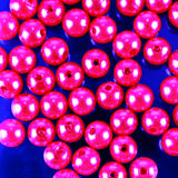 Shiny pink beads. On a shiny background Royalty Free Stock Photography