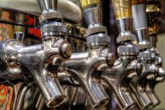 Shiny Beer Taps. Beer taps captured up close at the Yuengling Brewery in Pottsville, PA Royalty Free Stock Images
