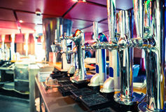 Shiny beer taps in a row Stock Photos