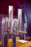 Shiny beer taps in a row Royalty Free Stock Photos