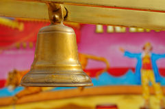 Shiny bell. Bell, shallow depth of field, clown and jumping tiger on background Stock Photo