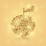Shiny Big Brown Apple on Yellow Background Royalty Free Stock Image