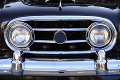 Shiny Black Car. Grill of a shiny black classic car Royalty Free Stock Image