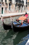 Shiny black gondolas in the canals of Venice Stock Photos