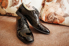 Shiny black men's shoes for the bride. Lying on the floor Royalty Free Stock Photo