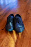 Shiny black men's shoes for the bride, lying on the floor Royalty Free Stock Photos
