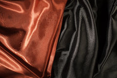 Shiny black and red satin fabric Royalty Free Stock Images