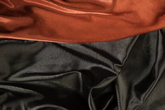 Shiny black and red satin fabric Stock Photography