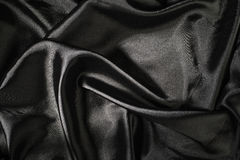 Shiny black satin fabric Stock Image