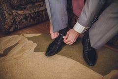 Shiny black shoe Stock Images