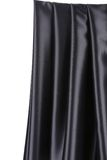 Shiny black silk drapery. Stock Photography
