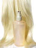 Shiny blond hair wave and spray Stock Photos