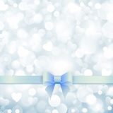 Shiny blue background with blue bow Royalty Free Stock Images