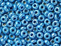 Shiny blue beads Stock Photos