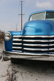 Shiny blue classic pickup truck. Front of a shiny, restored, blue 1953 classic American pickup truck parked on a railroad track with telephone poles in the Stock Photography
