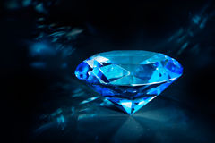 Shiny blue Diamond on a black background Stock Images