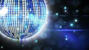 Shiny blue disco ball spinning around Stock Photos