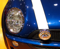 Shiny Blue Fender. A fender shines at an auto show stock image