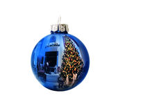Shiny Blue Holiday Ornament Reflects Brightly Lit  Royalty Free Stock Image