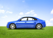 Shiny Blue Sedan In The Outdoors Royalty Free Stock Photos